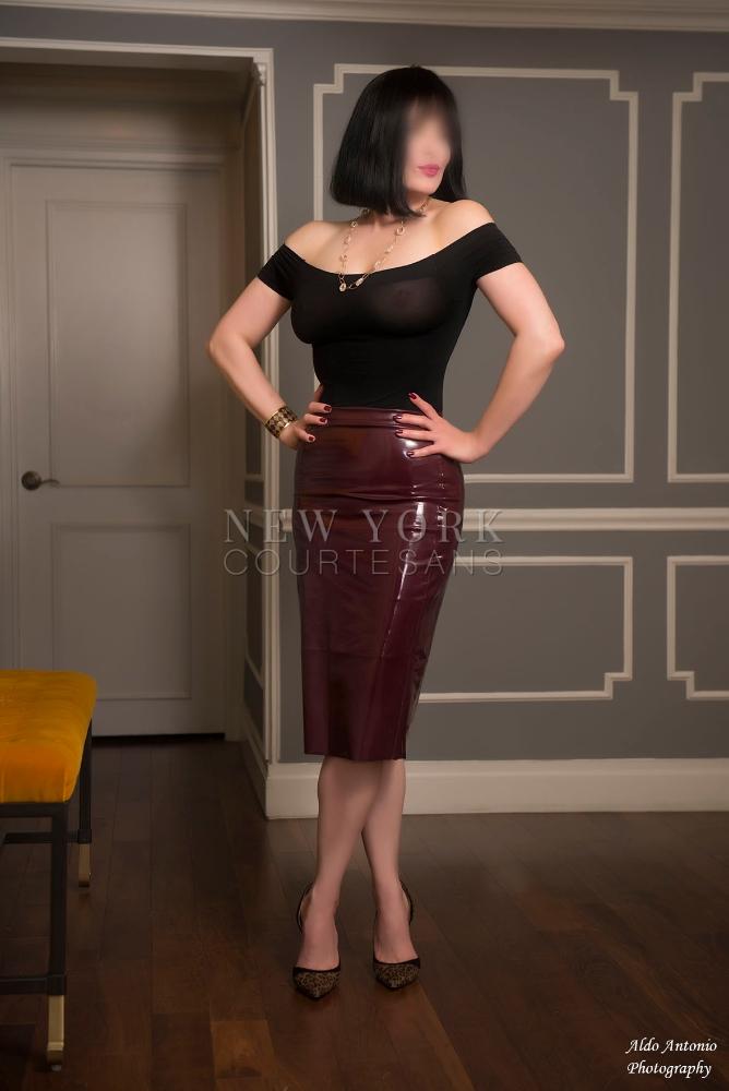 Glamorous mature escort Sara Charles in latex skirt black see-through top